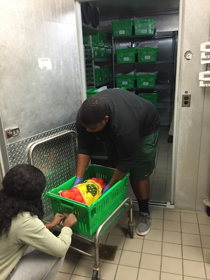 Students packing and labeling satsumas for delivery